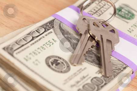House Keys on Stack of Money stock photo, House Keys on Stack of Money - Cash for Keys Program. by Andy Dean