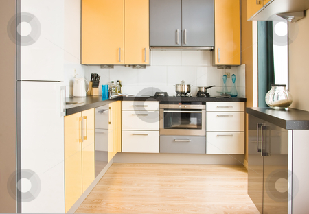 Colorful modern kitchen - horizontal stock photo, View into colorful modern kitchen in black, yellow and grey with wooden floor - horizontal by Colette Planken-Kooij