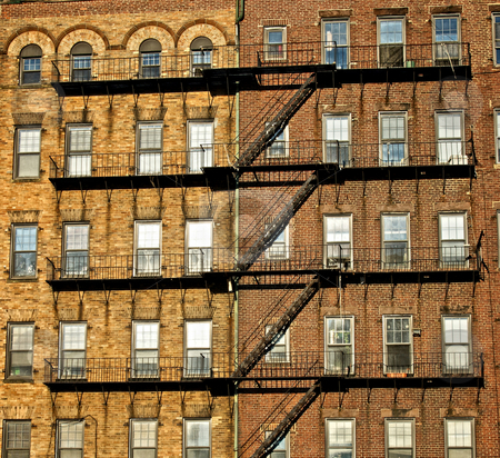 Attached stock photo, Fire escapes on old tenament buildings in boston massachusetts seemingly attaching the buildings together by Stephen Orsillo