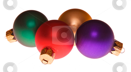 Ornaments stock photo, Four multi colored christmas tree holiday ornaments laying on their side by Stephen Orsillo