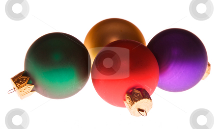 Xmas ornaments stock photo, Four multi colored christmas tree holiday ornaments laying on their side by Stephen Orsillo