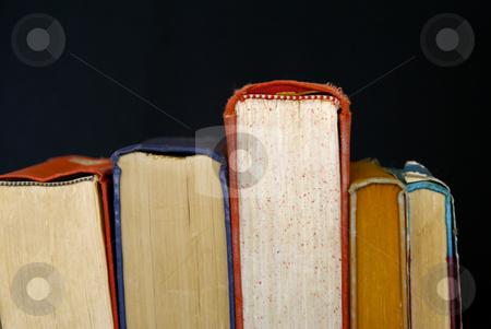 Book pages stock photo, Collection of old books seen from the top edge by Stephen Orsillo