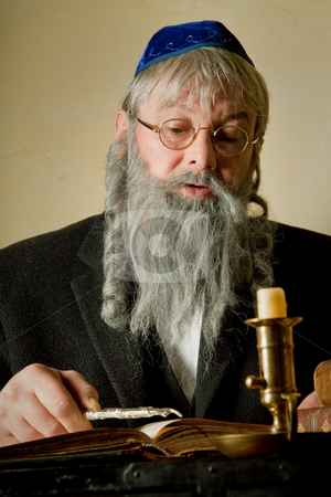 Torah pointer stock photo, Old jewish man with beard reading with a torah pointer by Anneke