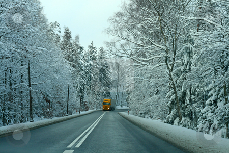 Winter scene stock photo, Yellow truck passing the snowy forest by Jan Remisiewicz