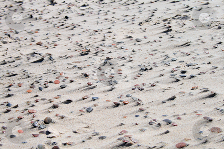 Texture of sand and stones on the beach stock photo, Natural sand and stone pattern on the beach, caused by the wind by Jan Remisiewicz