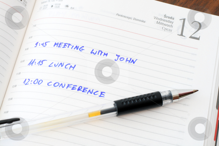 Diary stock photo, Diary with notes and a pen on wooden table by Jan Remisiewicz