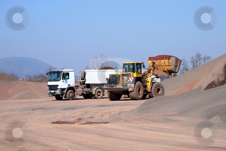 Loading scene stock photo, Heavy bulldozer loading ballast on the lorry by Jan Remisiewicz