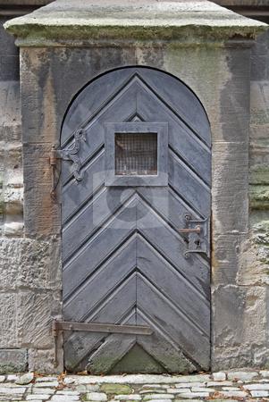 Old church door. stock photo, Old church door with a window at level of eyes. by Nikolaj Kondratenko