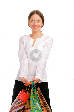 Pretty young female holding her shopping bags stock photo, Pretty young female holding her shopping bags , looking away smiling isolated on white by Roman Shyshak