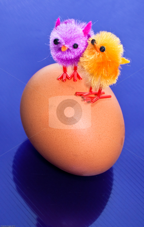 Chicks on an egg stock photo, Toy chicks on an egg by James Janisse