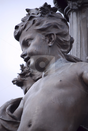 Little boy sculpyure1 stock photo, Close up on little boy iron sculpture on one of the parisian bridges by Olivia Neacsu