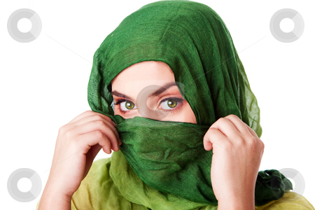 Face with green eyes and scarf stock photo, Portrait of mysterious beautiful Caucasian Hispanic Latina woman face with green penetrating eyes and holding green fashion scarf with hands in front of mouth and wrapped around head, isolated. by Paul Hakimata