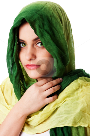 Face with green eyes and scarf stock photo, Portrait of mysterious beautiful Caucasian Middle Eastern woman face with green penetrating eyes and green fashion scarf wrapped around head, isolated. by Paul Hakimata
