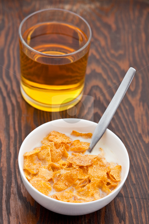 Breakfast cereal with milk and apple juice stock photo, Breakfast cereal with milk and fresh apple juice by Robert Anthony