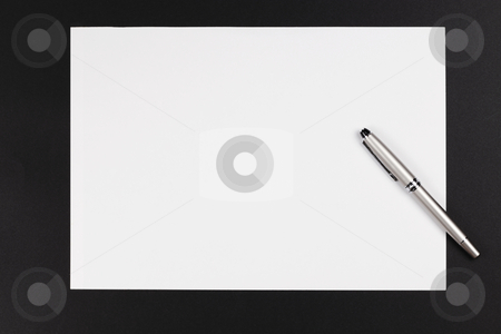 Pen and paper stock photo, A paper and pen on a black background by Adrin Shamsudin