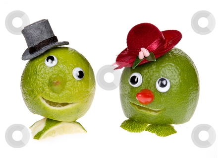Fruit faces stock photo, Funny fruit with face, googly eyes and hat by Anneke