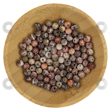 Multi color glass beads stock photo, Macro shot of  multi color glass beads on a small wooden bowl, isolated on white by Marek Uliasz
