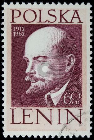 Lenin on a vintage post stamp stock photo, POLAND 1962 - portrait of Vladimir Lenin on a vintage canceled post stamp by Marek Uliasz