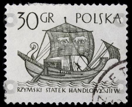 Ancient Roman trade ship stock photo, POLAND, circa 1960 - ancient Roman merchant sail ship on a vintage canceled post stamp, black drawing on white by Marek Uliasz