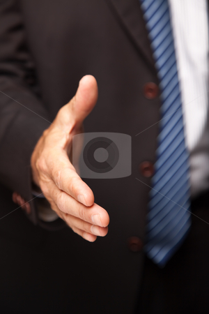 Businessman Reaching Out for Handshake stock photo, Businessman Reaching His Hand Out for a Handshake. by Andy Dean