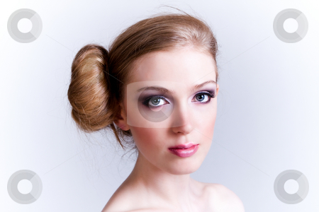 Attractive Young Woman stock photo, Attractive young woman with her hair in a bun looks towards the camera. Horizontal shot. by Angela Hawkey
