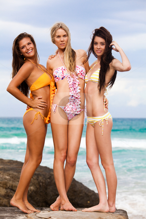 Three women in bikini swimwear