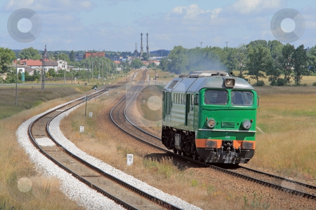 Diesel locomotive stock photo, Lonely diesel locomotive passing through countryside by Jan Remisiewicz