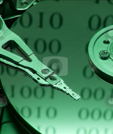 Harddisk stock photo, Internals of on open harddisk ith binary code reflection by P?