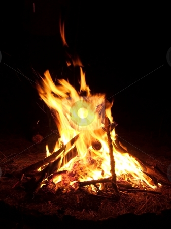 Campfire stock photo, Flames of a campfire burning in the night by P?