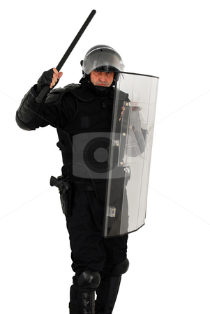 Riot policeman attack stock photo, Riot policeman attack by Goce Risteski