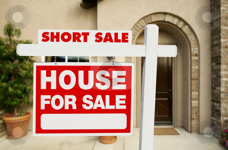 Short Sale Real Estate Sign and House stock photo, Red Short Sale Real Estate Sign and House. by Andy Dean