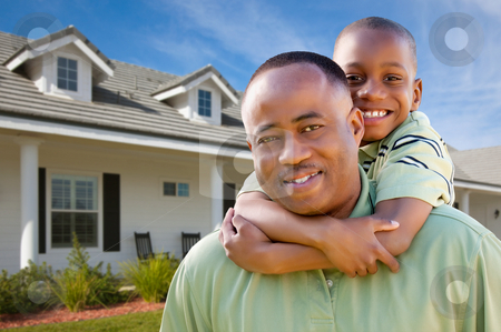 Father and Son Outside of Home stock photo, Happy African American Father and Son Outside of their Home. by Andy Dean