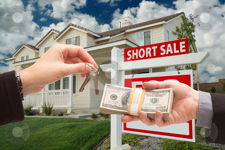 Handing Over Cash For House Keys and Short Sale Sign stock photo, Handing Over Cash For House Keys and Short Sale Real Estate Sign in Front of Home. by Andy Dean