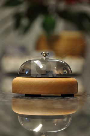 Hotel bell / Service bell stock photo, Detail shot of a service bell located on a hotel reception desk with blurred details in the background and reflection on marble counter by Frank G?