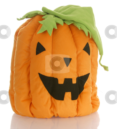 Halloween pumpkin stock photo, Stuffed pumpkin or jack-o-lantern with reflection on white background by John McAllister