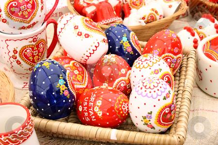 Painted eggs stock photo, Basket full of painted eggs before easter by Borislav Marinic