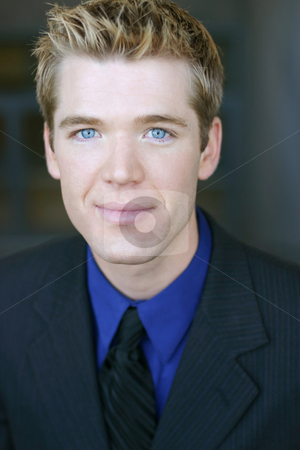 Blue eye business man stock photo, A business man portrait as he looks ahead with his blue eyes and blond hair by Daniel Vineyard