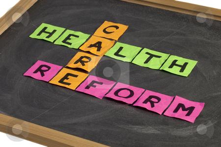 Health care reform crossword stock photo, Health care reform crossword - colorful sticky notes on a school blackboard with white chalk texture by Marek Uliasz
