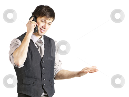 Young Businessman Talking on Phone. Isolated stock photo, A handsome young businessman with vest and rolled-up sleeves smiles while using a cordless phone. Horizontal shot. Isolated on white. by Ruta Balciunaite