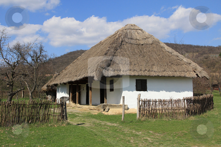 House stock photo, Rural thatched roof house in the hills. by Galló Gusztáv
