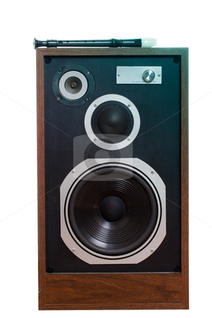 Music stock photo, A black and white recorder instrument is lying on top of a large old speaker, isolated against a white background by Richard Nelson