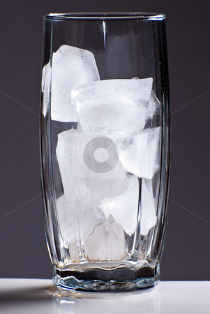 Glass of Ice stock photo, A tall glass filled with ice by Richard Nelson