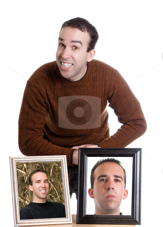 Self Portrait stock photo, A young man is smiling and standing next to self portraits of himself, isolated against a white background by Richard Nelson