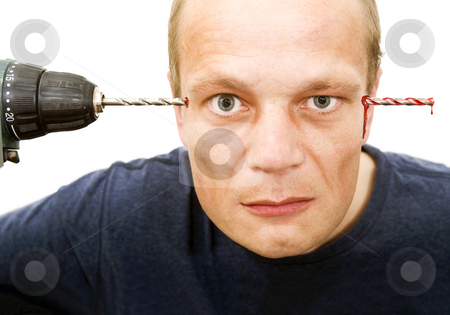 Drill through head stock photo, Conceptual image of a man, drilling through the temples of his head - crazed and insane by Corepics VOF