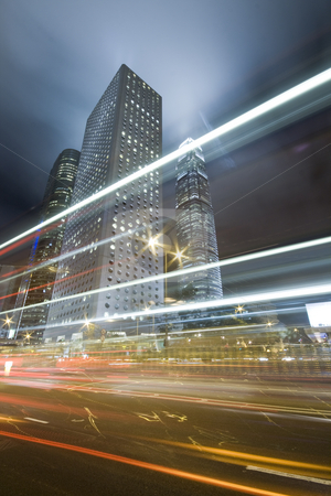 Traffic night stock photo, Hong Kong at night with highrise buildings by Keng po Leung
