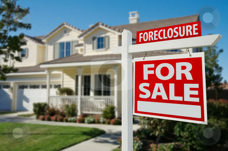 Foreclosure Real Estate Sign and House stock photo, Foreclosure Home For Sale Real Estate Sign in Front of New House. by Andy Dean
