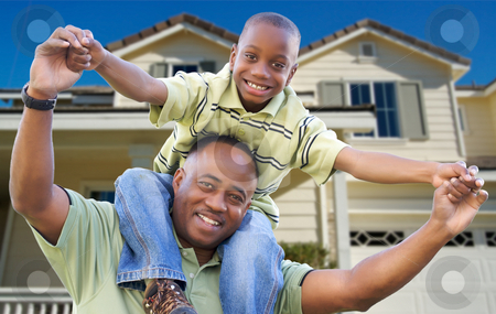 Playful Father and Son In Front of Home stock photo, Playful African American Father and Son In Front Yard of Home. by Andy Dean