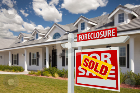 Sold Foreclosure Real Estate Sign and House - Right stock photo, Sold Foreclosure Home For Sale Real Estate Sign in Front of New House -  Right Facing. by Andy Dean