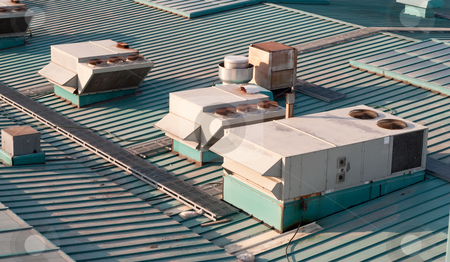 Building Air Vents stock photo, Air vents on top of a commercial building by Richard Nelson