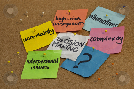 Decision making concept  stock photo, Problems in decision making process - uncertainty, alternatives, risk consequences, complexity, personal issues; color notes and pins on cork bulletin board board by Marek Uliasz